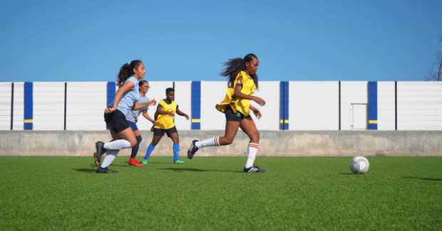 The women's national team of Curacao United, at practise on the football field.